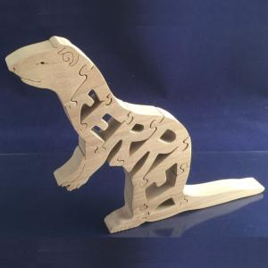 A wooden puzzle of a Ferret.