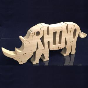 A wooden puzzle of a Rhinoceros, spelled RHINO.